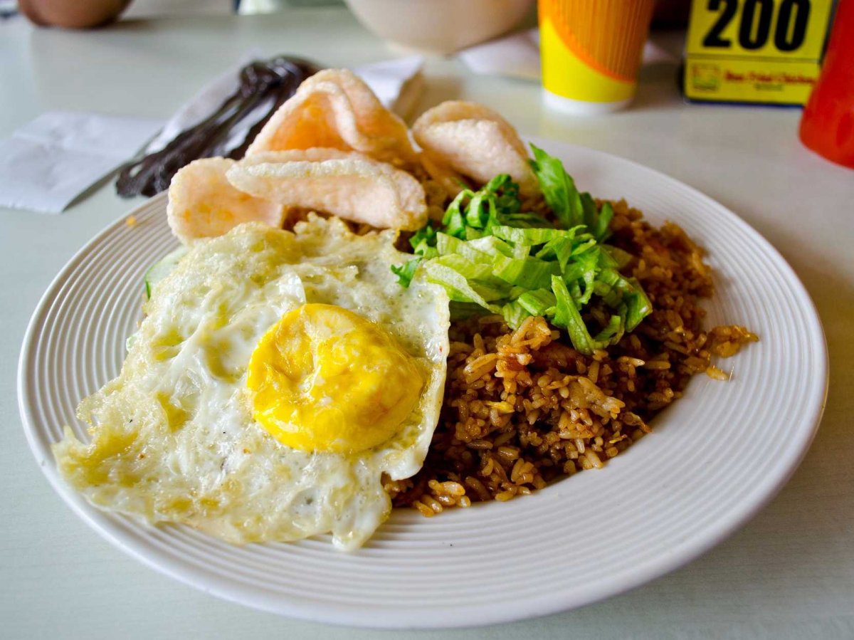 INDONESIA: Nasi goreng is commonly eaten in Indonesia for breakfast. The meals consists of a fried egg and fried rice, and sometimes meat or seafood as well.