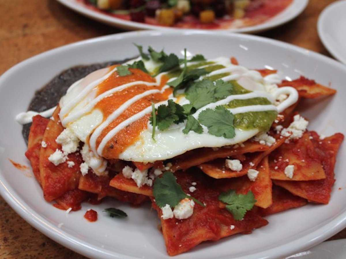 MEXICO: Mexican comfort food at its finest, chilaquiles are totopos (similar to tortilla chips) submerged in a spicy sauce with a fried egg and various toppings such as avocado.