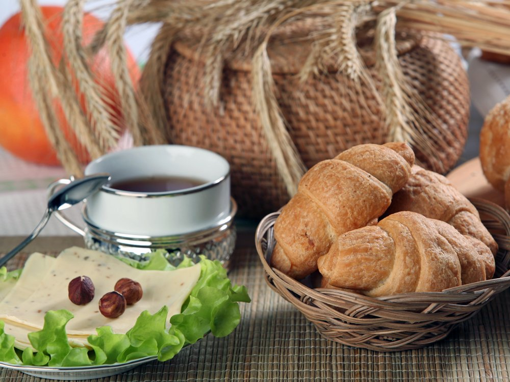 PORTUGAL: A standard breakfast includes stuffed croissants or bread with jam or cheese, eaten with coffee.